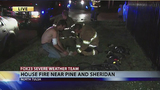 Firefighter shocked fighting north Tulsa fire