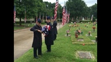 Cadets fix damaged flags at Floral Haven