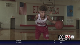 Dewey 8th grader overcomes paralyzed arm to play basketball
