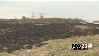 Large fire threatens homes, cattle