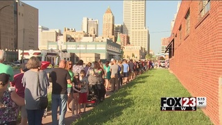 Hundreds line up for solar eclipse glasses in downtown Tulsa