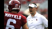 Oklahoma head coach Lincoln Riley, right, speaks with quarterback Baker Mayfield (6) before an NCAA college football game in Norman, Okla., Saturday, Sept. 16, 2017 (AP Photo/Mitch Alcala)
