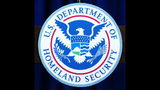 The recently unveiled seal of the U.S. Department of Homeland Security is shown displayed on a podium at a media conference announcing Operation Predator July 9, 2003 in Washington, DC. (Photo by Alex Wong/Getty Images)