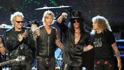 In this April 15, 2012 file photo, Guns N' Roses, from left, Matt Sorum, Duff McKagan, Slash and Steven Adler appear on stage at their induction into the Rock and Roll Hall of Fame in Cleveland.  AP Photo/Tony Dejak, File