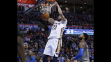 New Orleans Pelicans forward Anthony Davis (23) dunks between Oklahoma City Thunder forward Carmelo Anthony (7) and center Steven Adams (12) during the first half of an NBA game in Oklahoma City, Friday, Feb. 2, 2018. (AP Photo/Sue Ogrocki)