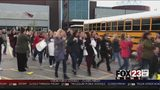 VIDEO: Jenks teachers ride school buses down to the Capitol