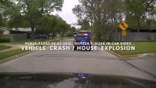 Dash cam video shows house explosion in Texas