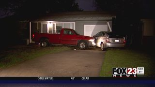 VIDEO: Driver crashes into east Tulsa cars, causes home damage