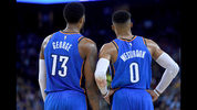 OAKLAND, CA - FEBRUARY 06: Paul George #13 and Russell Westbrook #0 of the Thunder looks on against Golden State during the second half of their NBA game at ORACLE Arena in Oakland, California. (Photo by Thearon W. Henderson/Getty Images)