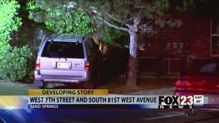 SUV crashes into Sand Springs building