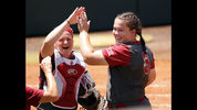 Oklahoma's Lea Wodach, left, and Paige Parker react after retiring Arkansas in an NCAA college championship super regional softball game Saturday, May 26, 2018, in Norman, Okla. (Steve Sisney/The Oklahoman via AP)