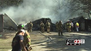 Firefighters stop Berryhill garage fire from spreading to home