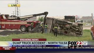 Dump truck and trash truck tip over on Highway 169