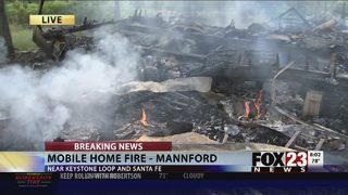Firefighters on the scene of house fire in Mannford