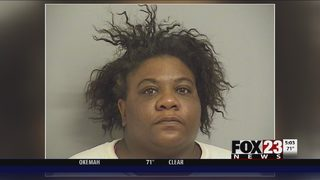 Tulsa woman accused of running someone over twice and hitting a police car