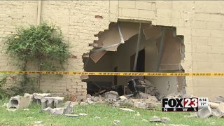 Car leaves hole in the wall of north Tulsa building