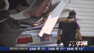 Suspect arrested after chase, crashing car into house