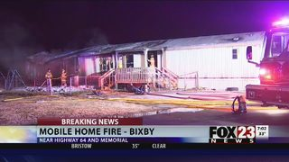 Firefighters battle fire at Bixby mobile home