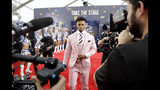 Oklahoma quarterback Kyler Murray walks the red carpet ahead of the first round at the NFL football draft, Thursday, April 25, 2019, in Nashville, Tenn. (AP Photo/Steve Helber)
