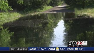 Wagoner County deputies rescue people from deep water after road sign is stolen