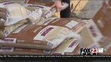 VIDEO: Sand bags fly off Bixby shelves to help prepare for possible flooding