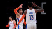 Russell Westbrook #0 and Paul George #13 of the Oklahoma City Thunder celebrate a dunk during the first half against the Los Angeles Lakers at Staples Center on January 02, 2019 in Los Angeles, California. (Photo by Harry How/Getty Images)