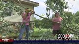 VIDEO: Jay neighbors pull together to clear tornado debris