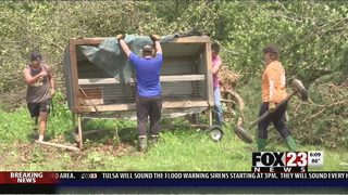 VIDEO: Jay High School Football Team helps clean up after tornado ripped through their town