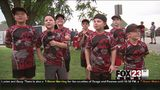 WATCH - Sand Springs baseball team helps flood victims with food, smiles