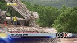 VIDEO: Crews reinforce sides along Keystone Dam with large rocks