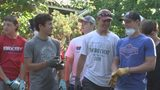 Bixby football players help teammate clean up home after flooding.