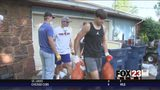 WATCH - Bixby flooding brings football team together to help teammate