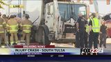 VIDEO: Crews work to free person trapped in car involved in garbage truck crash in south Tulsa
