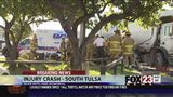 VIDEO: Woman freed from car involved in garbage truck crash in south Tulsa