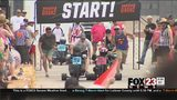 VIDEO: Boulder Dash adult tricycle races start in downtown Tulsa