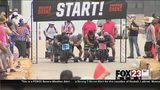 VIDEO: Downtown Tulsa hosts its first Boulder Dash tricycle race