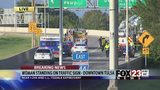 VIDEO: Downtown Tulsa highway closed as police respond to woman on sign